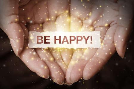 Foto de Be happy text on hand design concept - Imagen libre de derechos