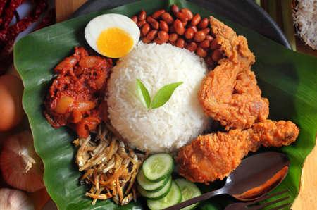 Foto de Nasi lemak is a dish that comprises rice made fragrant with coconut cream and pandan leaves.  - Imagen libre de derechos