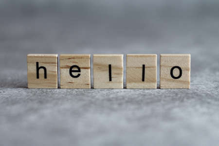 Photo for Hello word written on wood cube with gray background. - Royalty Free Image