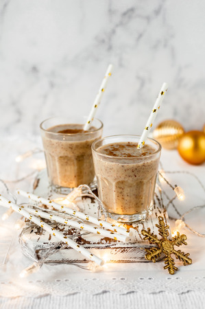 Photo for Two Glasses of Date Milkshake with Cinnamon, Christmas Atmosphere, copy space for your text - Royalty Free Image