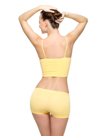 Photo pour Back view of a perfect female body with thin waist posing isolated on white background - image libre de droit