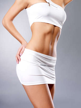 Photo for Beautiful healthy female body in white sport clothes - Royalty Free Image