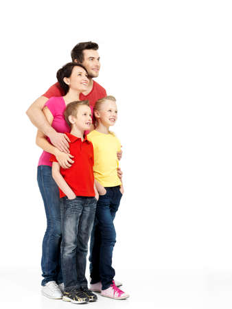 Photo for Full portrait of the happy young family with two children looking up isolated on white background - Royalty Free Image