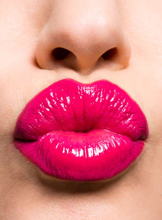 Closeup image of a  beautiful sexy red lips giving kiss