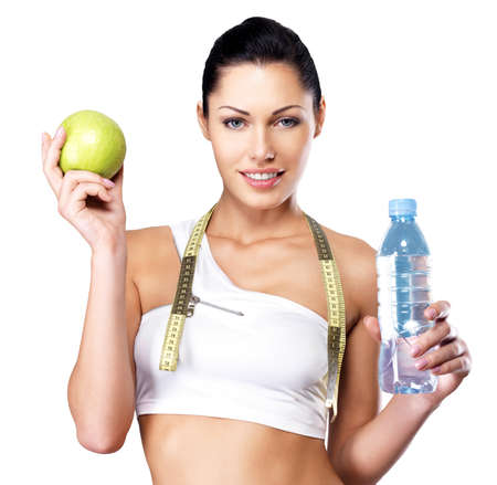 Photo pour Portrait of a healthy woman with apple and bottle of water. Healthy fitness and eating lifestyle concept.  - image libre de droit