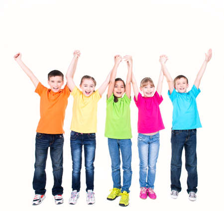 Photo pour Group of smiling kids with raised hands in colorful t-shirts standing together - isolated on white. - image libre de droit