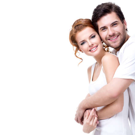 Photo pour Cheerful happy young couple looking at camera - isolated on white background. - image libre de droit