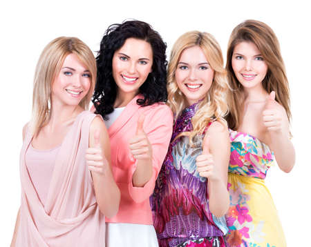 Photo for Group of young beautiful happy women with thumbs up sign posing at studio over on white background. - Royalty Free Image