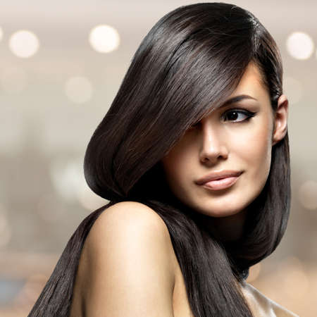 Foto de Beautiful woman with long straight hair. Fashion model posing - Imagen libre de derechos