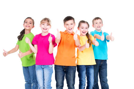 Photo pour Group of happy kids with thumb up sign in colorful t-shirts standing together -  isolated on white. - image libre de droit