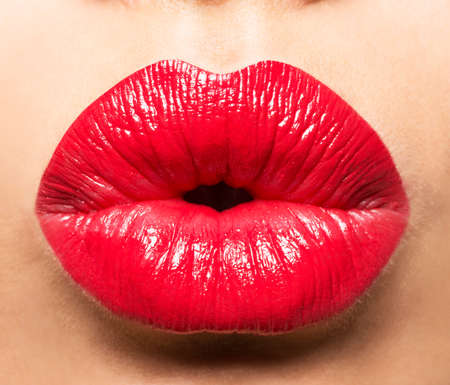 Photo pour Woman's lips with red lipstick and  kiss gesture - image libre de droit