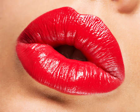 Photo for Woman's lips with red lipstick and  kiss gesture - Royalty Free Image