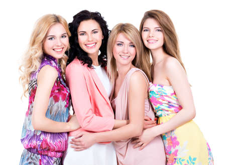 Photo pour Group young beautiful smiling women in pink dresses - isolated on white. - image libre de droit