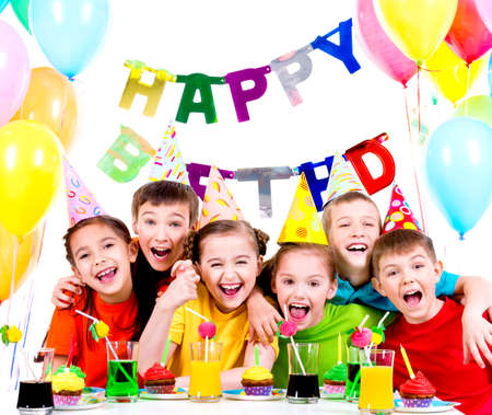 Photo pour Group of laughing kids having fun at the birthday party - isolated on a white. - image libre de droit