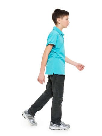 Photo for Full portrait of walking teen boy in blue t-shirt casuals  isolated on white background. - Royalty Free Image