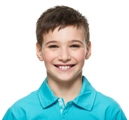 Photo pour Portrait of  young happy teen boy looking at camera. - image libre de droit