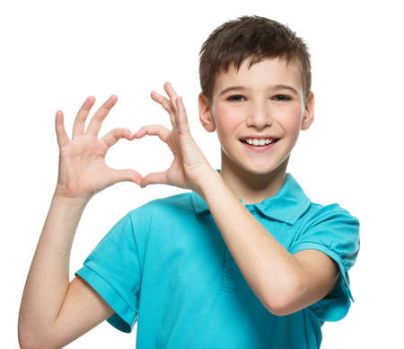 Foto de Portrait of happy  teen boy with a heart shape isolated on white background - Imagen libre de derechos
