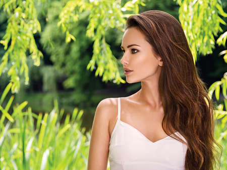 Photo pour portrait of the young beautiful woman with long hairs. outdoors. - image libre de droit