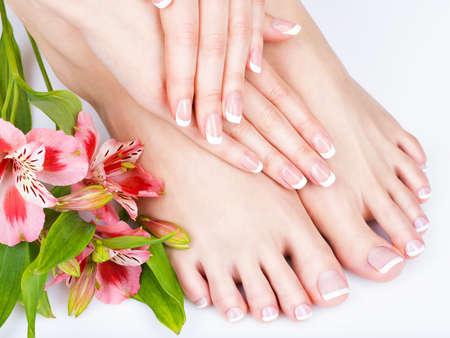 Foto de Closeup photo of a female feet at spa salon on pedicure and manicure procedure - Soft focus image - Imagen libre de derechos