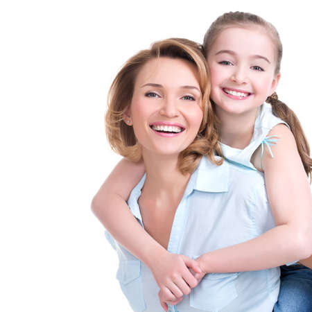 Foto de CLoseup portrait of happy  white mother and young daughter - isolated. Happy family people concept. - Imagen libre de derechos