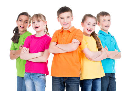 Photo pour Group of smiling children with crossed arms in colorful t-shirts standing together on white background. - image libre de droit