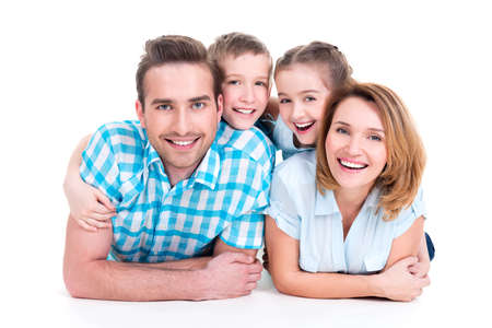 Photo pour Caucasian happy smiling young family with two children lying down on the  floor - image libre de droit