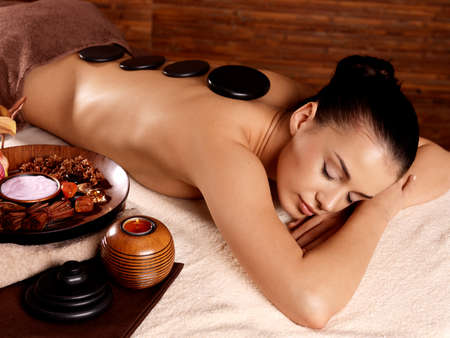 Photo for Young woman having stone massage in spa salon. Healthy lifestyle. - Royalty Free Image