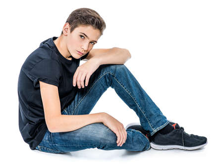 Photo pour Photo of teenage handsome guy posing at studio. Fashion portrait of cute pretty teen boy - image libre de droit