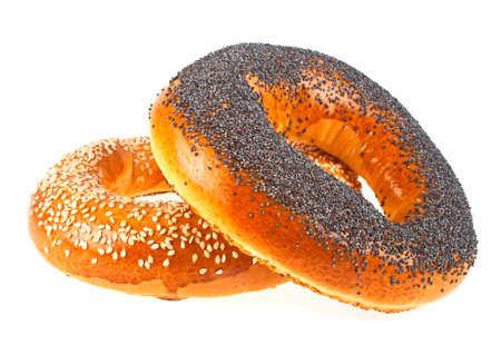 Foto de Tasty bagels with sesame and poppy seeds on a white background - Imagen libre de derechos