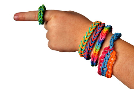 Foto de Little boy wearing colorful loom band rubber bracelets and ring (isolated  on white) - Imagen libre de derechos