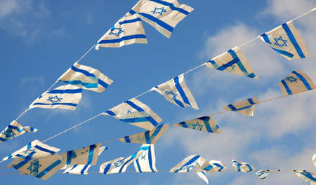 Israel flag in white and blue showing the Star of David hanging proudly for Israel\'s Independence Day (Yom Haatzmaut)