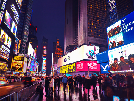 Foto für NEW YORK, MARCH 14, 2015: Times Square at night - HDR featuring busy Broadway with animated signs for the Lion King and other shows.  Theater District is a symbol of New York and the United States. - Lizenzfreies Bild
