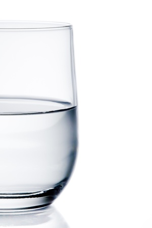 Foto de half glass of pure water with space for text on white background - Imagen libre de derechos