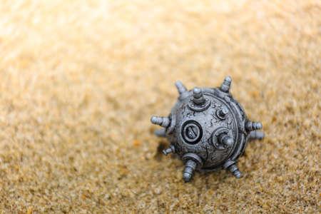 Photo pour silver color plastic mine toy on the sands - image libre de droit