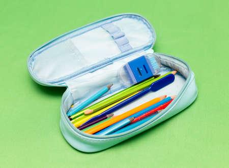 Photo pour children's school pencil case on a green background - image libre de droit