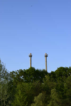 Foto de Cellular antennas at the top of the chimney. Telecommunications tower. Receiver-transmitter of the signal. Cellular aerials repeater. - Imagen libre de derechos