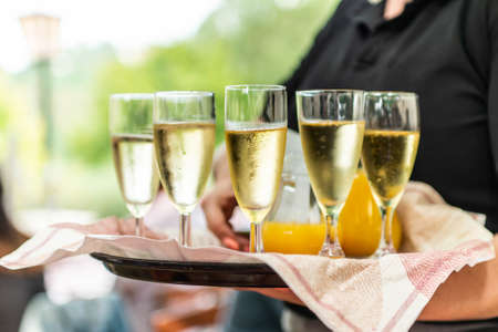 Photo for Champagne or sparkling wine in glasses in restaurant served by servant - Royalty Free Image