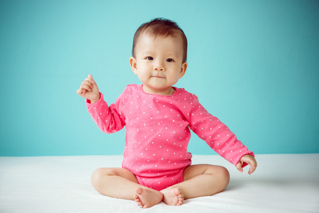 Photo pour Asian baby girl wearing pink clothing - image libre de droit