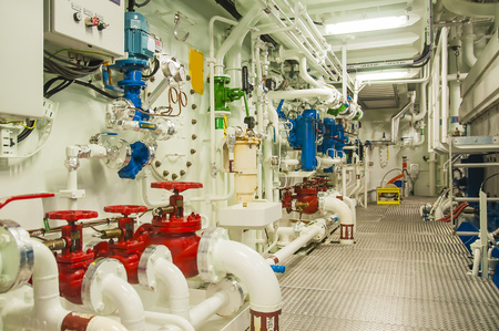 Photo pour Interior of modern offshore vessel with complicated machinery, pumps, engines and valves - image libre de droit