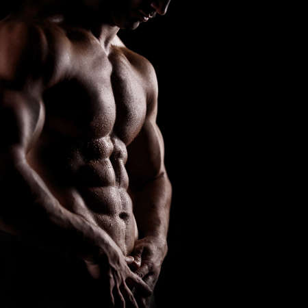 Foto de strong athletic man on black background - Imagen libre de derechos