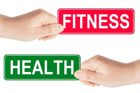 Foto per Fitness and Health traffic sign in the hand on the white background - Immagine Royalty Free