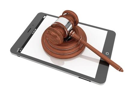 Foto de Online Business Concept. Tablet PC with a gavel on a white background - Imagen libre de derechos