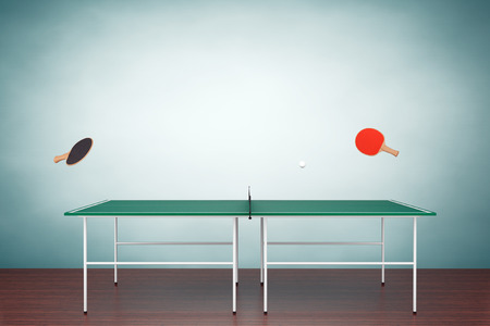 Table tennis table with Paddles on the floor