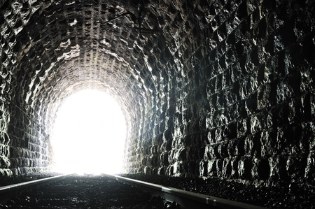 light on end of train tunnel representing new life and success concept