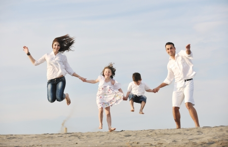 Photo pour happy young family have fun and live healthy lifestyle on beach - image libre de droit
