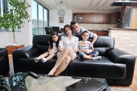 happy young family relax and have fun at modern home indooor