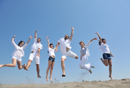 Photo for happy people group have fun  run and jump  on beach beautiful sand  beach - Royalty Free Image