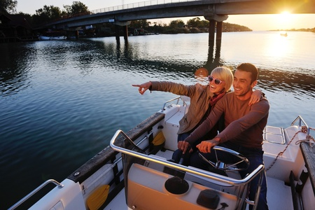 Photo pour happy young couple in love  have romantic time at summer sunset   at ship boat while  representing urban and countryside fashin lifestyle - image libre de droit