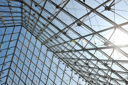 Foto per Metal roof top structure with glass construction background from Museum  du Louvre in paris france - Immagine Royalty Free