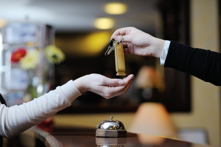 Photo for business woman  at the reception of a hotel checking in - Royalty Free Image